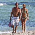 Carlos Ponce frolics on the beach with girlfriend Ximena Duque