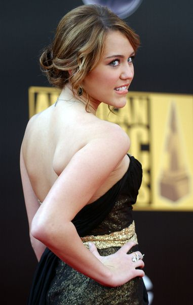 Miley Cyrus at 2008 American Music Awards - Arrivals at Nokia Theater, Los Angeles, CA. USA