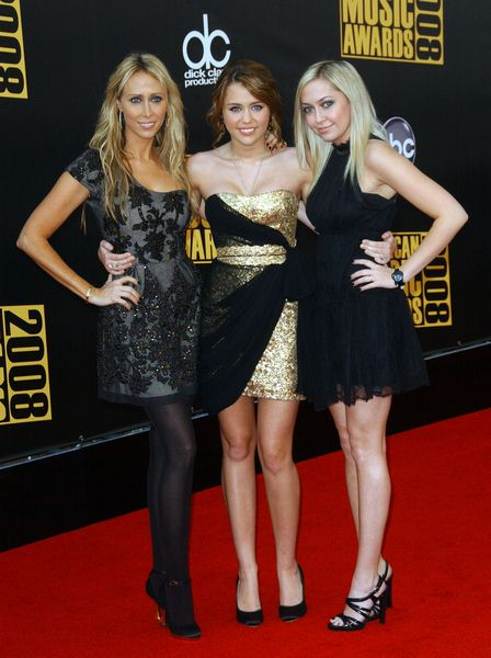 Miley Cyrus, Mother, Sister at 2008 American Music Awards - Arrivals at Nokia Theater, Los Angeles, CA. USA