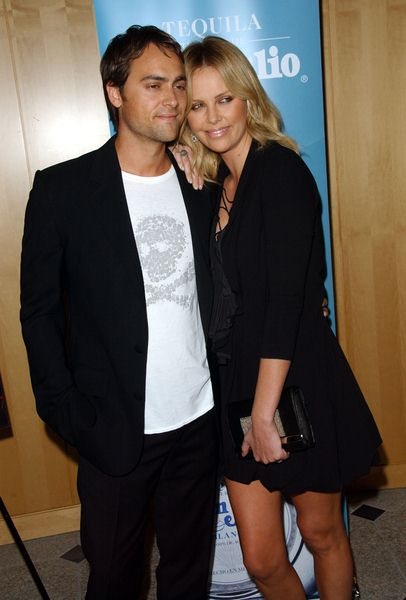 Stuart Townsend, Charlize Theron at 'Battle In Seattle' Special Screening - Arrivals at Clarity Theater, Beverly Hills, CA. USA