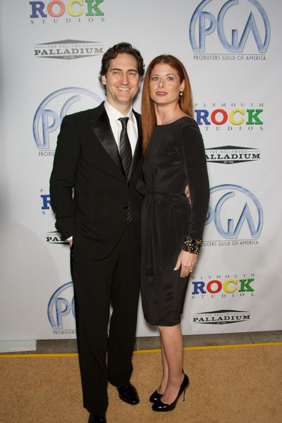 Daniel Zelman, Debra Messing at 20th Annual Producers Guild Awards at The Hollywood Palladium, Los Angeles, CA USA