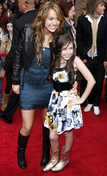 Miley Cyrus, Ryan Newman at 'Hanna Montana The Movie' World Premiere - El Capitan Theatre, Hollywood, CA, USA