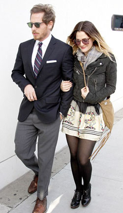 Drew Barrymore smartens up her act for her new man